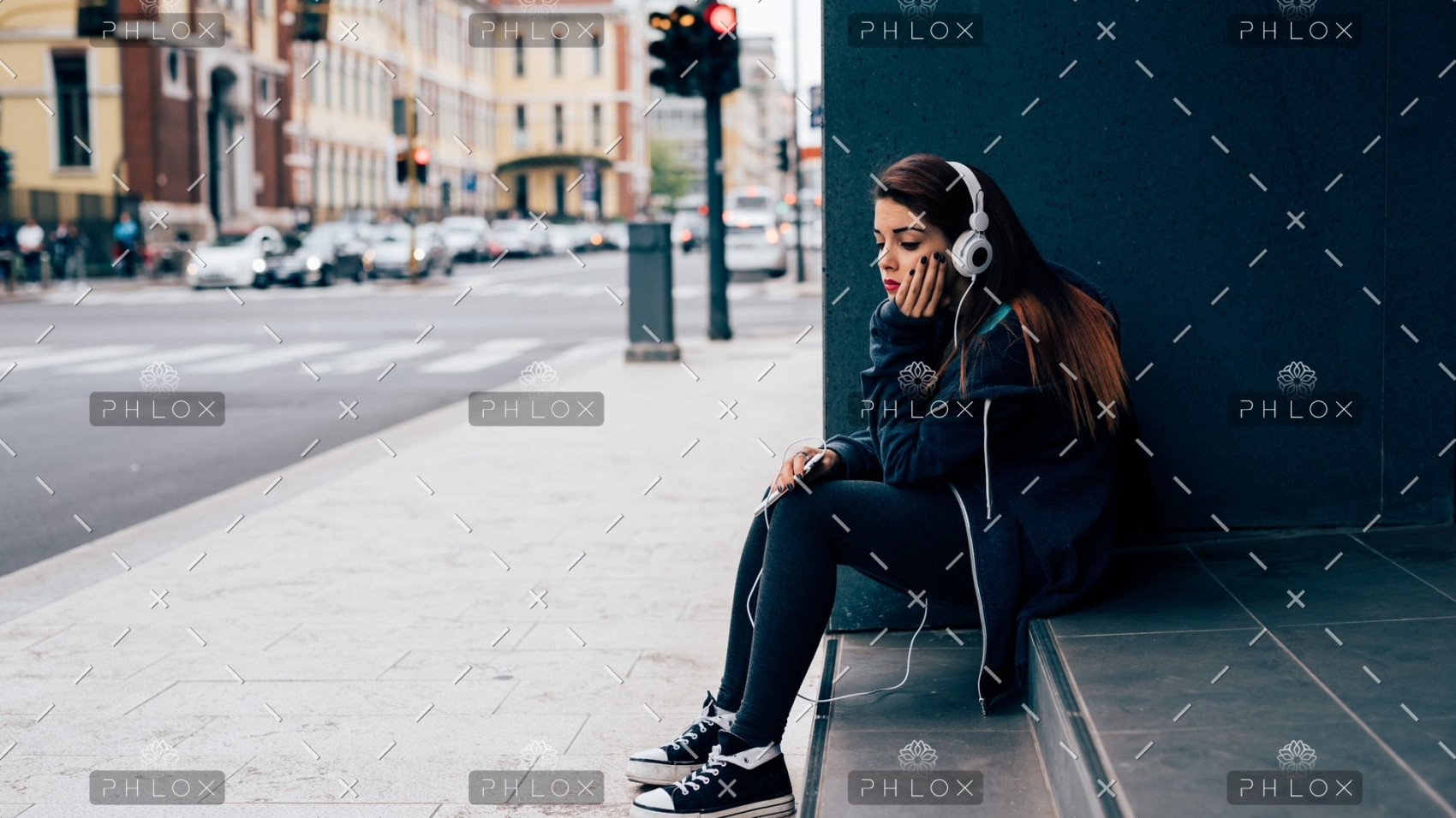 demo-attachment-19-young-woman-sitting-on-a-step-PE6MPZ9