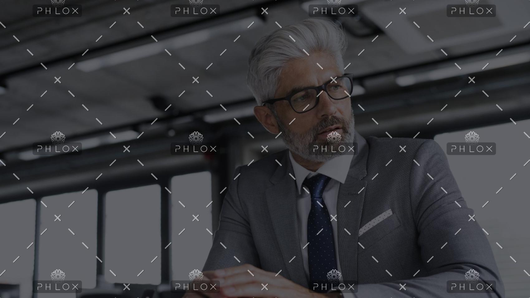 demo-attachment-15-mature-businessman-in-gray-suit-in-the-office-PJSC8AZ